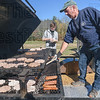 Grill chef Paul Jacques serves up a burger to Logan Day during Saturday's WHOA event at Moses Scout Reservation.