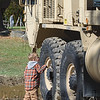 Dylan Liimatainen sees just how big a military vehicle is at Saturday's Woronoco Heights Outdoor Adventure event at the Moses Scout Reservation.