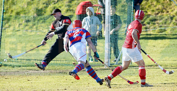 Winning strike - Keith MacRae fires the winning goal beyond the reach of Dawson in the Kingussie goal.