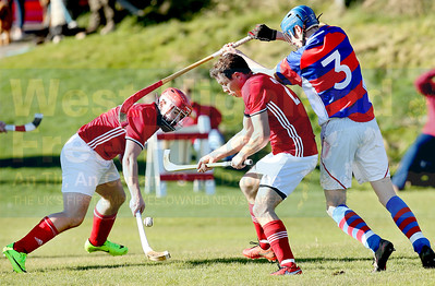 Gordy MacDonald and Scott MacLean apply pressure to Kingussie defender Alexander Michie.