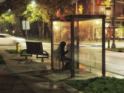 Girl at bus stop at Lincoln and Wyandotte
