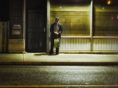 Man waiting for a bus on Wyandotte Street East
