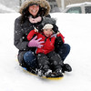 TIM JEAN/Staff photo. Tabitha Lamson sleds down the hill with her son Cameron, 3, during the snowstorm in North Andover Saturday afternoon.  1/24/15