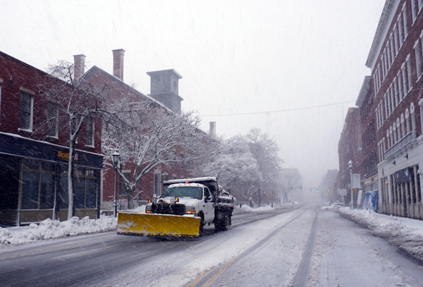 . Lone plow on Market street in Lowell with limited visability. (The SUn / Chris Tierney)