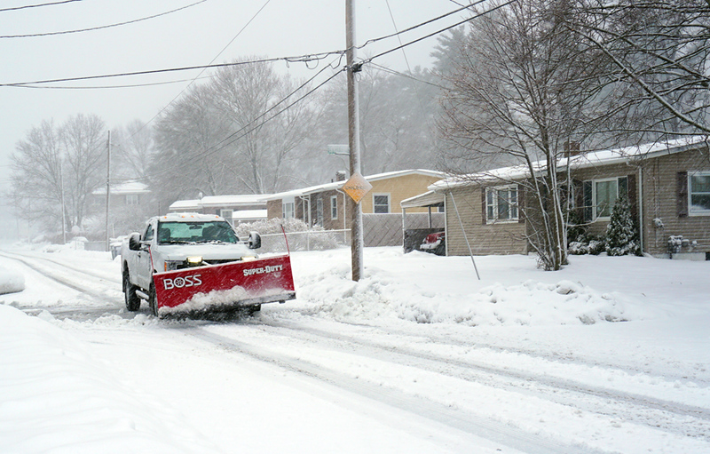 . A plow truck on Bryant Ave in Dracut. (The Sun / Chris Tierney)