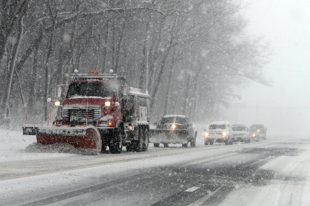 . Snow plow on Rt 38 in Tewksbury.  (SUN/Julia Malakie)
