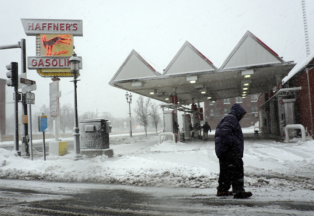 . A Man walks down Market Street in Fornt of Haffners gas station. (The Sun / Chris Tierney)