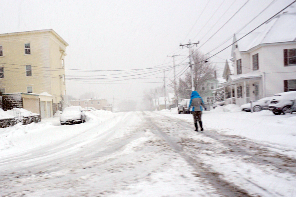 . Unidentified woman walks down Fouth Ave in Lowell. (The Sun / Chris Tierney)
