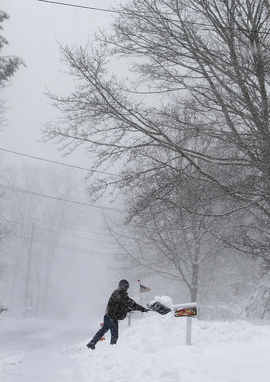 . Michael Fama of Billerica does a second pass shovelling his driveway on Pages Court. (SUN/Julia Malakie)