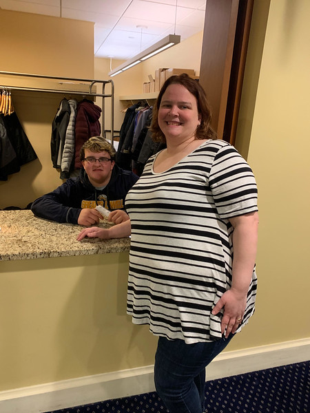 Great coat-checker Eli Meehan with mom, Chrissy Meehan, of Lowell