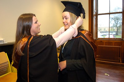 Provision 251006 Gemma Ryan (Waterford) fixes Alana Nolan's (Skibbereen, Cork) troublesome mortar board before they go into their graduation ceremony in WIT yesterday (Weds). Both graduated with a BA (Hons) in Legal Studies with Business. PIC Bernie Keating/Provision