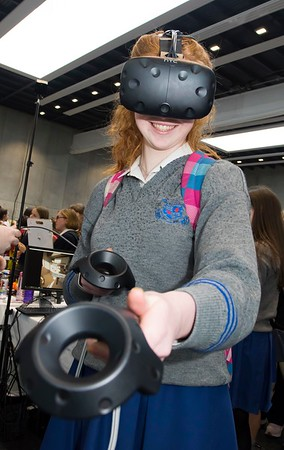 "8/3/2018 Image Free to Use Waterford Institute of Technology celebrate international women's day. Be brave in the choices you make – secondary school students hear on International Women's Day  Caoimhe Holland Loretto Kilkenny with Virtual reality goggles.Photo;Mary Browne Be brave in the choices you make – secondary school students hear on International Women's Day  For immediate release Hundreds of female secondary school students were inspired by the career path of Women in Technology keynote speaker Regina Moran, Vice President of Transformation, EMEIA, Fujitsu on International Women's Day in Waterford.  The event was co-ordinated by lecturers from Waterford Institute of Technology and featured 10 female speakers telling their personal stories.  Moran told the audience how it's important to be adaptable to change – she changed roles at least 30 times, lived through recessions and boom times, layoff and hirings, had been promoted and demoted – and survived.  ""I have had and still intend to have an amazing career but way back in the 1980s it began here in this college and for that I will always be grateful,"" she said.  ""I chose to do engineering back when it was an unusual choice for a girl. It opened up a world of possibilities. The road less travelled led to becoming CEO of Fujitsu in Ireland for 10 years and last May I became CEO of Fujitsu UK and Ireland, an amazing role. I have just recently taken on a European wide role.""  Speakers and representatives from 30 companies showcased technology careers to young women this International Women's Day in Waterford. Hundreds of second-level students from across the south east region – Gorey, Enniscorthy, Fermoy, Kilkenny, Carrick-on-Suir, Waterford city – descended on the Women in Technology event on International Women's Day 2018 at the WIT Arena which has been organised by lecturing staff in physics, engineering, architecture and computing disciplines at Waterford Institute of Techn"