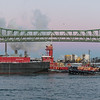 The tug Jane A. Bouchard heads out to sea past the Tobin Bridge in Boston Harbor.