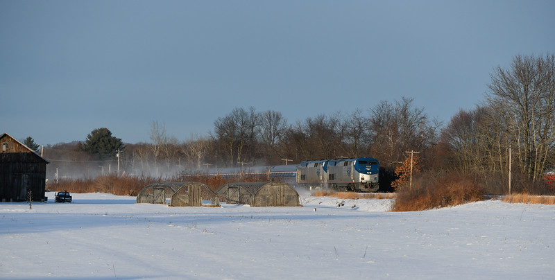 A late running Vermonter rushes through the snow in Hatfield on MassDOT's Conn River Line in Western Massachusetts.