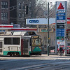 The Street running E Branch of the Green Line passing another Citgo Sign on Huntington Ave in Boston.