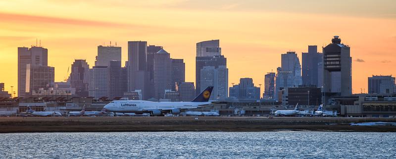 Lufthansa flight 423 talking off with Boston skyline.