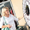 WKU '81 Alum Sandy Miller spins the wheel.