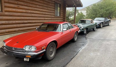 At the Borg cabin. Dil and Diane Strasser's V12 XJS, followed by the Lay E-type and the Viper.