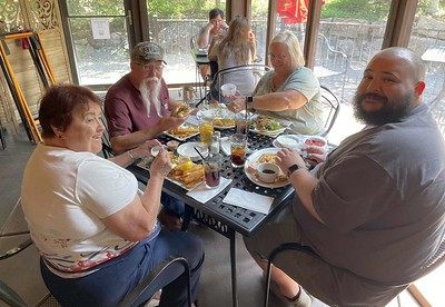 We got comfortable seating on their screened in patio. Clockwise from lower left are Kay, James, Susan and Jackson Jennings.