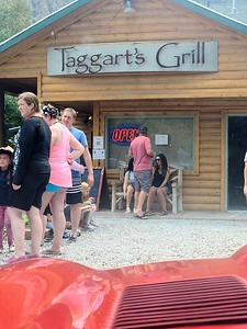 There was a short wait at Taggarts Grill which as always was jammed with weekend customers. Jim and Hermione chose to wait in their E-type which was positioned right in front. Photo by Jim Klekas.