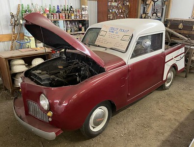 This is a quite rare Crosley CC Pickup Truck.  Perhaps at most a large suitcase could be its maximum payload?