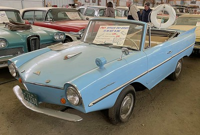 As they say, the Amphicar is a poor car and a worse boat.  Actually the drive train underneath (but not the propeller) is all Triumph Herald / Spitfire.