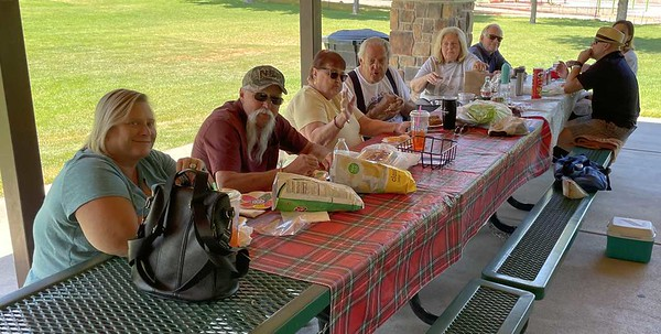 A family hosting a birthday party kindly let us use one end of their pavilion.  Clockwise from lower left are Susan, James and Kay Jennings, Mike and Susan Cady, Craig Call, and Julie and Rick Southwick.