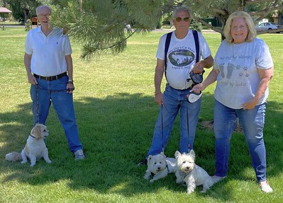 It was K9 Pandemonium at times, but here peace has broken out. From left to right Ken and Bennie Borg, Abby, Mike, Tess and Susan Cady.
