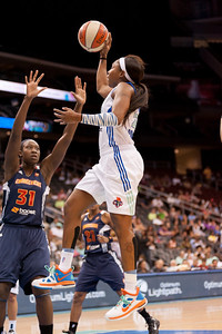 New York's CAPPIE PONDEXTER (23) drives to the basket over Connecticut's TINA CHARLES (31).