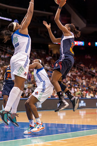 Connecticut's ALLISON HIGHTOWER (23) attempts to drive past CAPPIE PONDEXTER and KIA VAUGHN (15) of New York.