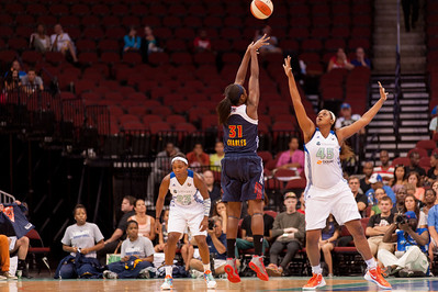 Connecticut's TINA CHARLES (31) pulls up for a shot over New York's KARA BRAXTON (45).