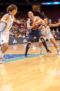 Connecticut's KARA LAWSON looks to pass while being defended by NICOLE POWELL (14)  and LEILANI MITCHELL (5).