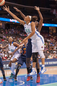 New York's PLENETTE PIERSON (33) drives past Connecticut's TINA CHARLES.