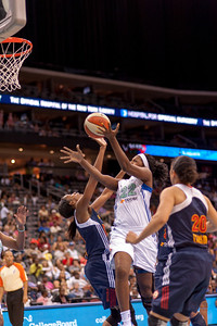 New York's DEMYA WALKER (22) drives past Connecticut's TINA CHARLES.