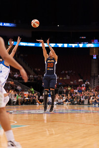 Connecticut's KARA LAWSON pulls a jumper from three-point range against the New Yokr Liberty.