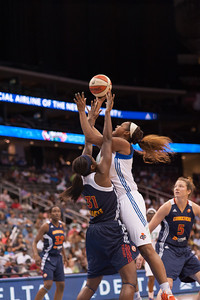 New York's KARA BRAXTON attempts a shot over Connecticut's TINA CHARLES (31)