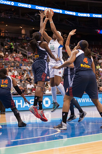 New York's KIA VAUGHN (15) shoots over Connecticut's TINA CHARLES.