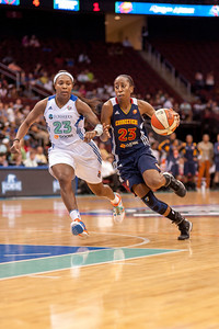 Connecticut's ALLISON HIGHTOWER (23) attempts to drive past CAPPIE PONDEXTER of New York.