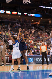 Connecticut's RENEE MONTGOMERY drives to basket past New York's LEILANI MITCHELL (5).