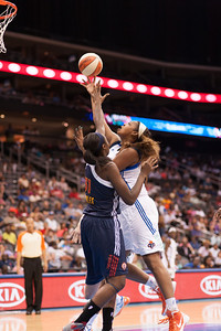 New York's KARA BRAXTON drives past Connecticut's TINA CHARLES.