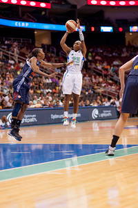 New York's CAPPIE PONDEXTER (23) pulls up for a jjump shot against the Connecticut Sun's ALLISON HIGHTOWER.