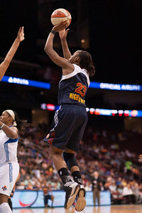 Connecticut's ALLISON HIGHTOWER attempts a jump shot against the New York Liberty.
