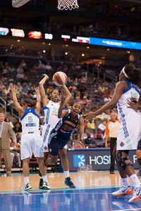Connecticut's RENEE MONTGOMERY drives to basket past New York's LEILANI MITCHELL (5) and ALEX MONTGOMERY (21).