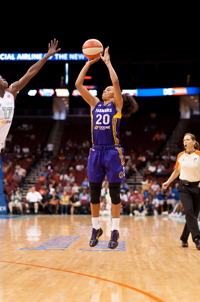 Los Angeles' KRISTI TOLIVER (20) pulls a jump shot as New York's ESSENCE CARSON (17) defends.