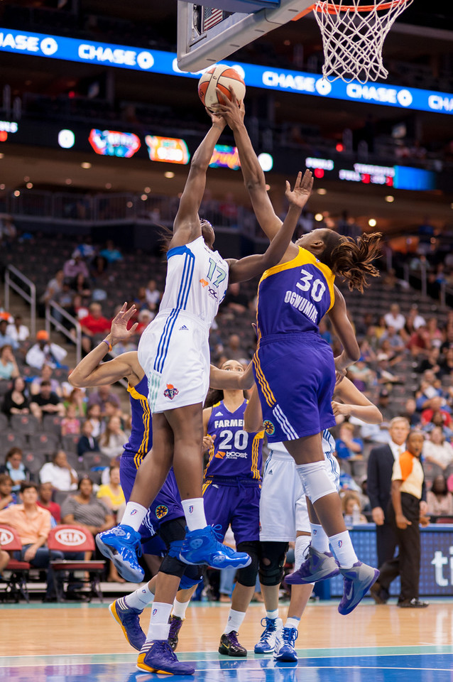 The Sparks' NNEKA OGWUMIKE (30) blocks a shot by the Liberty's ESSENCE CARSON (17).