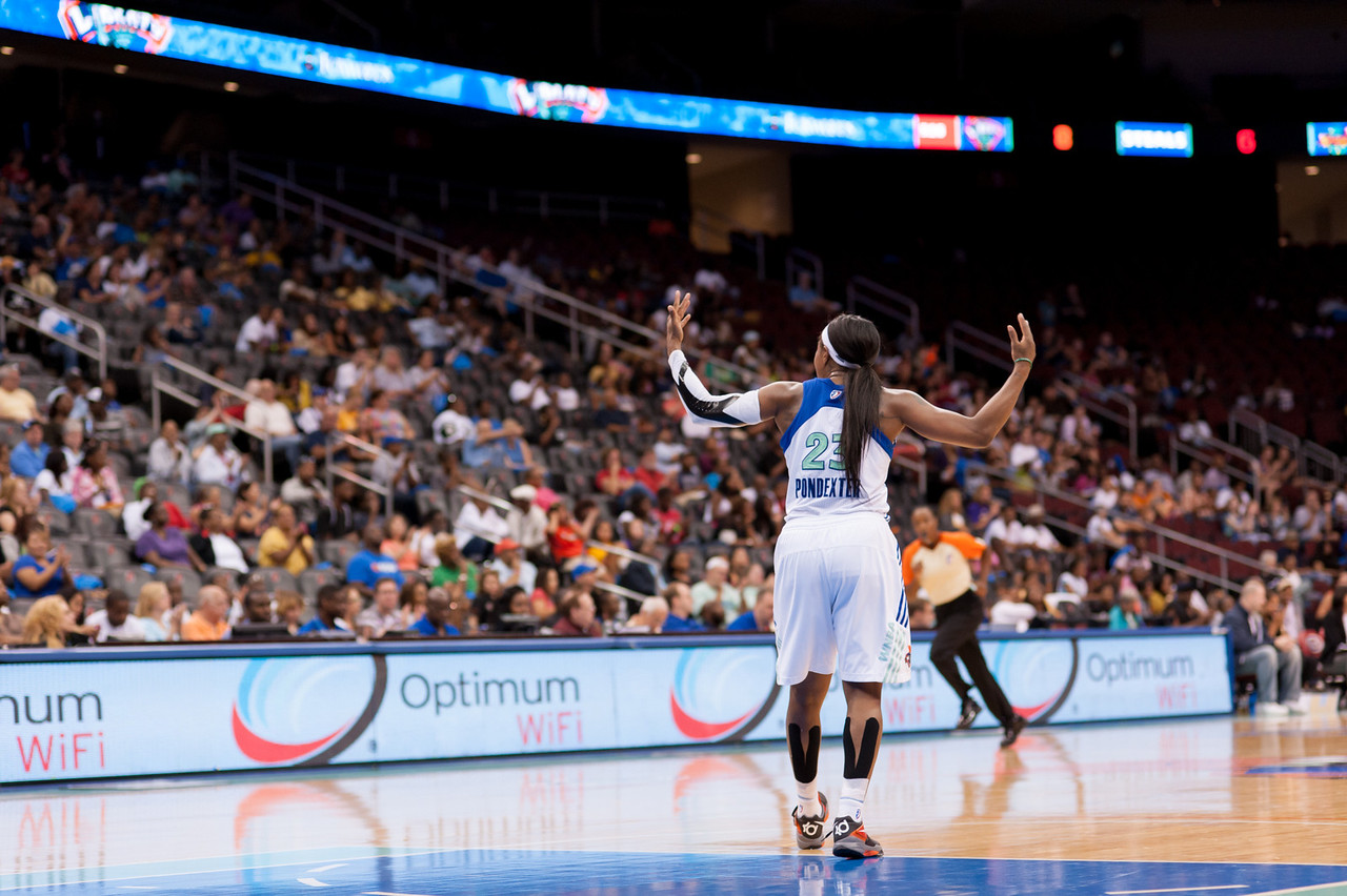 New York's CAPPIE PONDEXTER  pumps up the crowd at a home game against the Los Angeles Sparks.