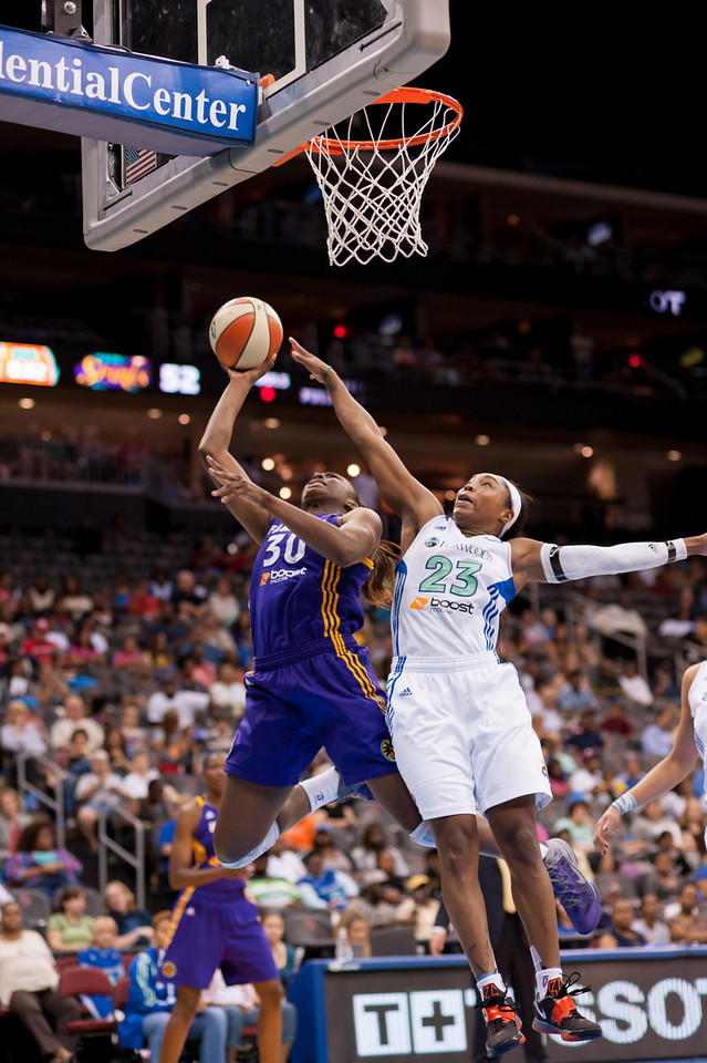 New York's CAPPIE PONDEXTER (23) defends a shot attempt by Los Angeles' NNEKA OGWUMIKE (30).