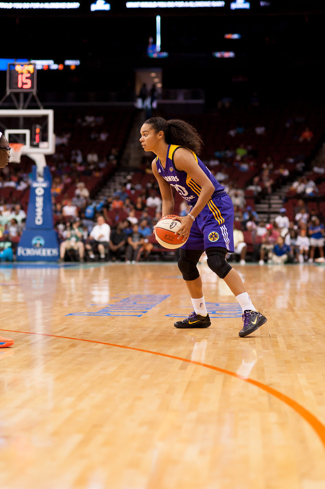 Los Angeles' KRISTI TOLIVER looks to make a move against the New York Liberty.