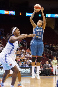 Minnesota's SEIMONE AUGUSTUS (33) pulls up for a jump shot as New York's DEMYA WALKER (22) calls out defensive assignments.