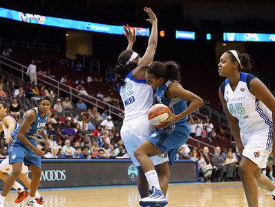 New York's DEMYA WALKER (22) fouls Minnesota's CANDACE WIGGINS (11) as she drives through the lane.
